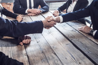 Business people shaking hands at business meeting